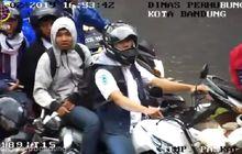Pembonceng Nggak Pakai Helm Kena Tegur CCTV, Bengong Dikasih Puisi