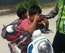 Ditilang, Anak SD Ini Menangis Sejadinya dan Menciumi Tangan Polisi