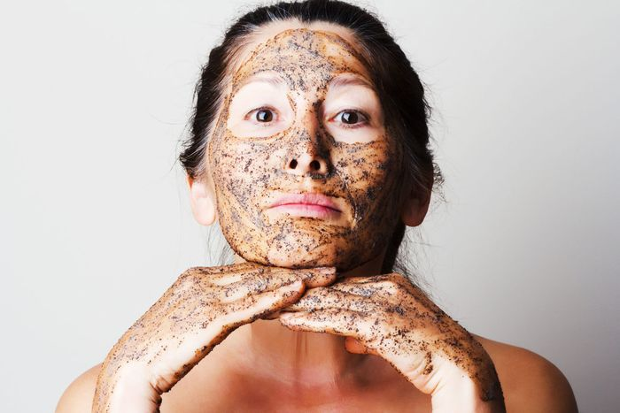- mature woman making cosmetic mask from coffee, sour cream.