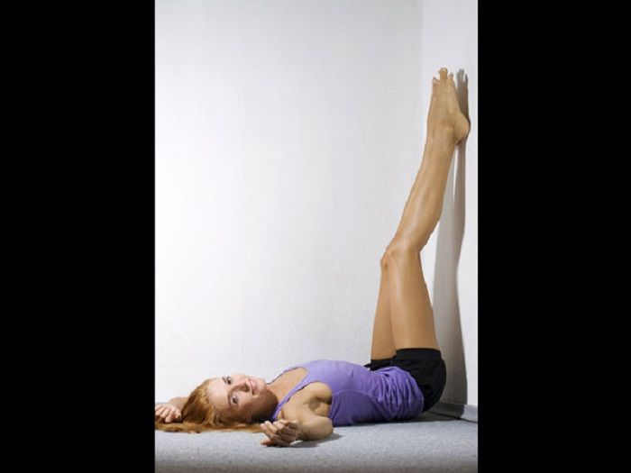 Yoga poses tie your feet to the wall