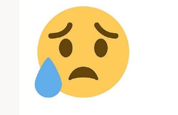 Gambar emoji wajah sedih dengan satu tetesan keringat