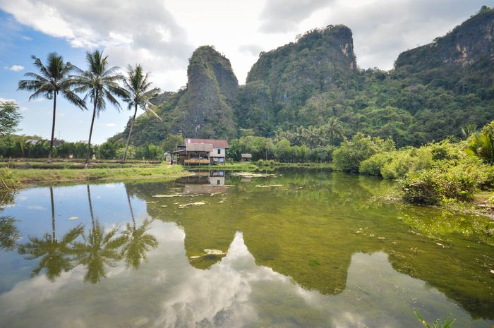 Beautiful limestones and water reflections in Rammang Rammang park near Makassar, South Sulawesi, In