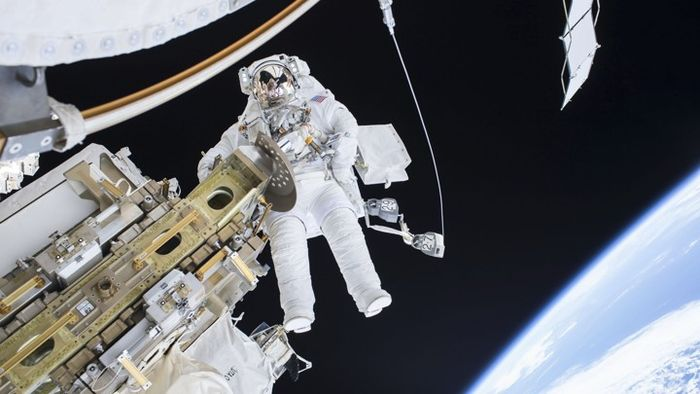 Expedition 46 Flight Engineer Tim Kopra performs a spacewalk outside the International Space Station