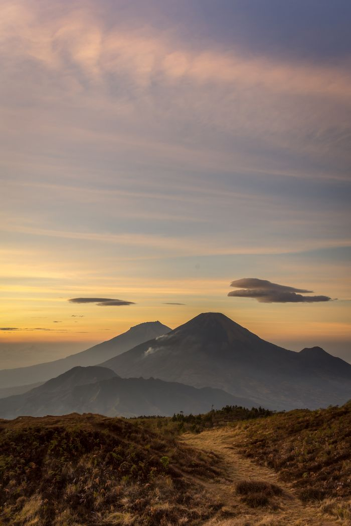 Golden sunrise at Prau Mountain with Sindoro and Sumbing mountain on the background