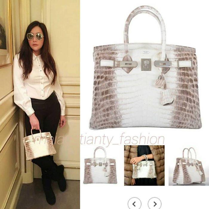 Maia Estianty tampak membawa tas mewah miliaran rupiah yang mirip dengan yang dibawa Syahrini