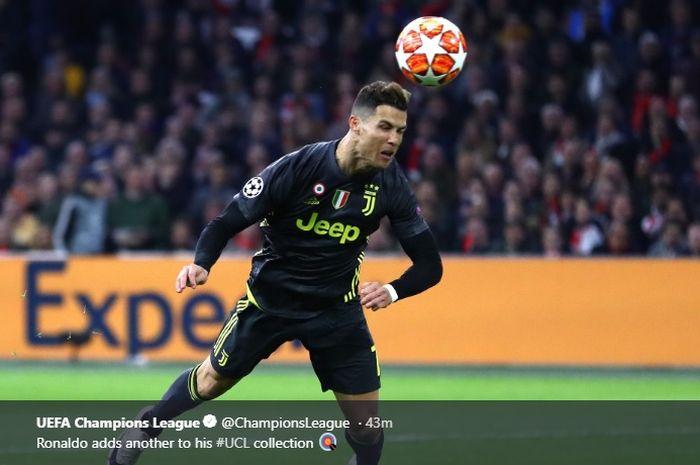 Cristiano Ronaldo menyundul bola, menyambut umpan silang dari Joao Cancelo di pertandingan leg pertama perempat final Liga Champions melawan Ajax Amsterdam, Rabu (10/4/2019)