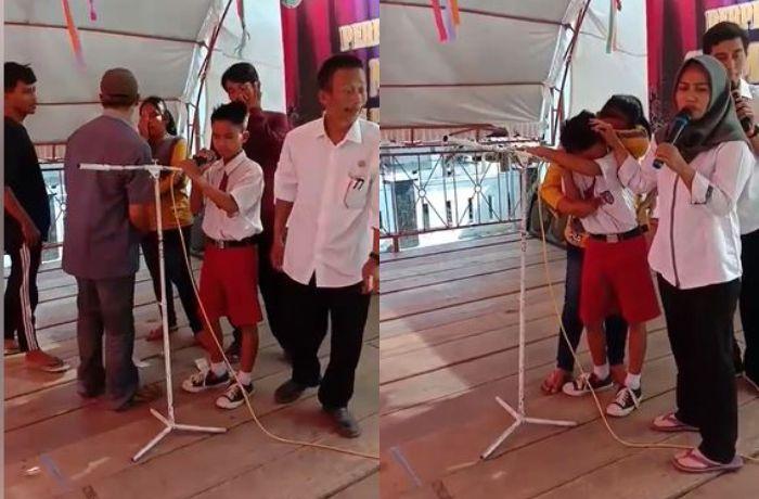 Seorang bocah SD yang menangis sesegukan saat menyayikan lagu untuk mendiang ayahnya.