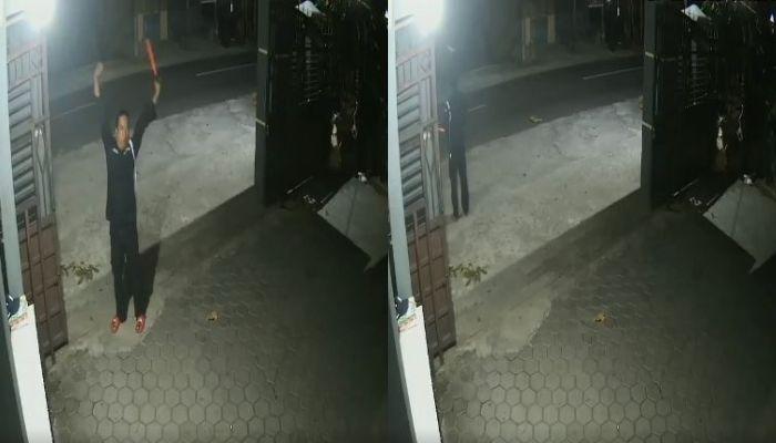 Rekaman CCTV penampakan pocong dibonceng pengendara bermotor.