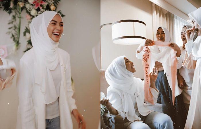Tampilan Citra Kirana saat bridal shower dengan busana nuansa putih