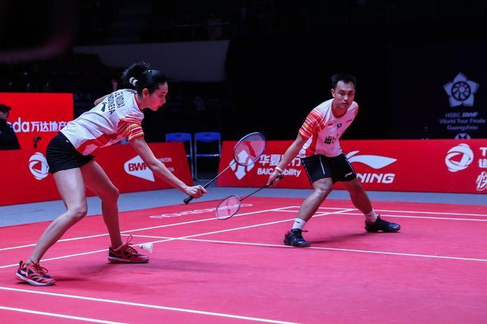 Ganda campuran Indonesia, Hafiz Faizal/Gloria Emanuelle Widjaja, tampil pada laga perdana Grup B BWF World Tour Finals 2019 di Tianhe Gymnasium, Guangzhou, China, Rabu (11/12/2019)