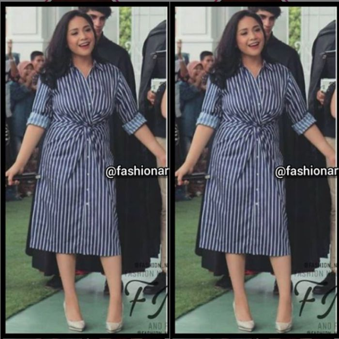 Penampilan Nagita Slavina tampil modis kenakan midi dress motif stripes