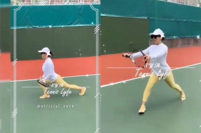 Syahrini tengah asyik olahraga tenis