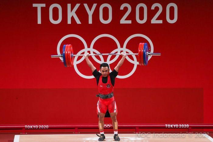 Lifter Indonesia Eko Yuli Irawan saat berjuang di kelas 61 kg angkat besi putra Olimpiade Tokyo 2020, Minggu (25/7/2021) siang WIB.