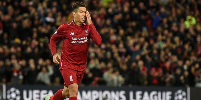 Penyerang Liverpool FC, Roberto Firmino, merayakan gol yang dicetak ke gawang Crvena Zvezda dalam la