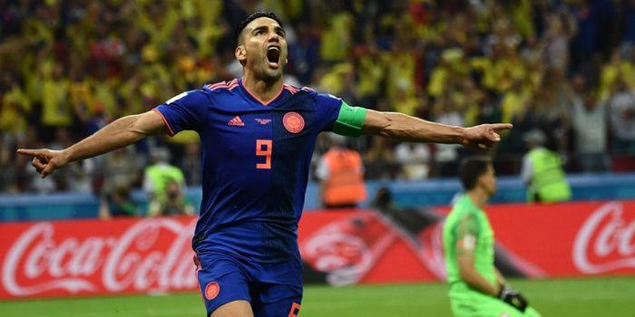 Penyerang Kolombia, Radamel Falcao, merayakan gol yang dicetak ke gawang Polandia dalam laga Grup H