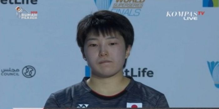 Ekspresi Akane Yamaguchi sesaat sebelum sesi pemberian hadiah usai memenangi partai puncak BWF Sup