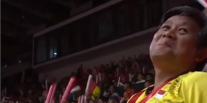 Senyum Herry IP (pelatih Marcus/Kevin ) pada pertandingan final Indonesia Masters 2018,  Minggu (28/
