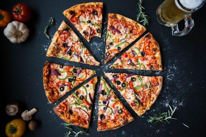 Makan pizza setelah olahraga ternyata baik untuk tubuh