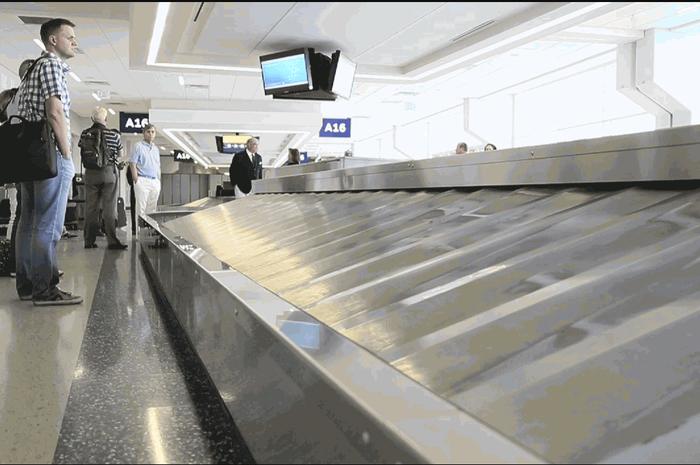 ilustrasi ambil koper di Bandara