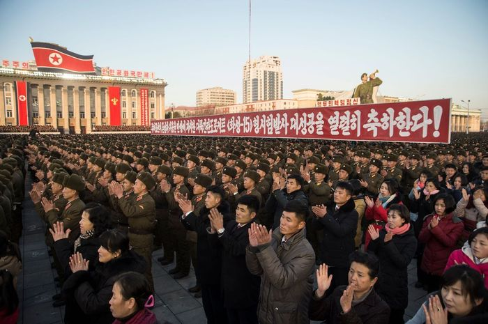 North Koreans attend a mass rally to celebrate the North's declaration on November 29