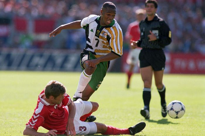 South Africa's Quinton Fortune (centre) is tackled by Denmark's Marc Rieper (on floor)