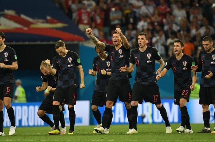 Pemain timnas Kroasia merayakan kemenangan dan melaju final Piala Dunia 2018