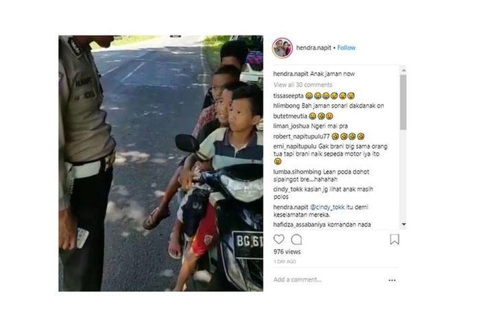 Video polisi menilang empat anak yang berboncengan naik sepeda motor