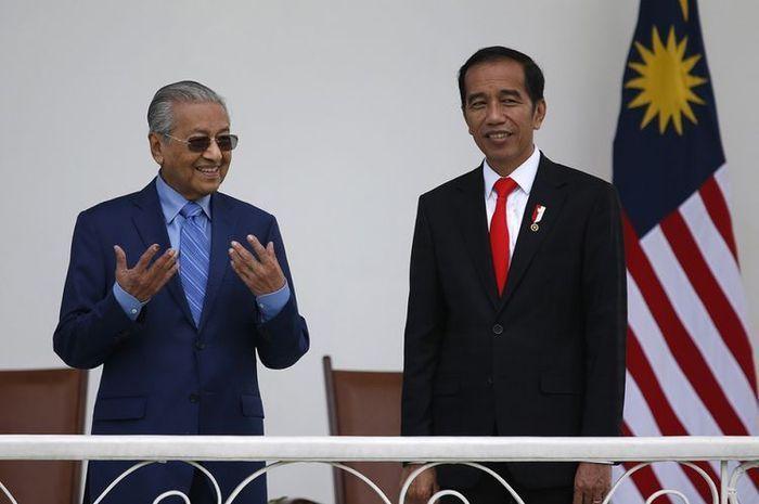 Perdana Menteri Malaysia Mahathir Mohammad dan Presiden RI Joko Widodo.