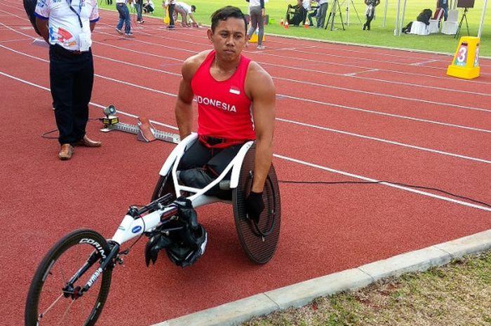Atlet difabel Indonesia, Jaenal Aripin, seusai menjalani lomba pada test event Asian Para Games 2018