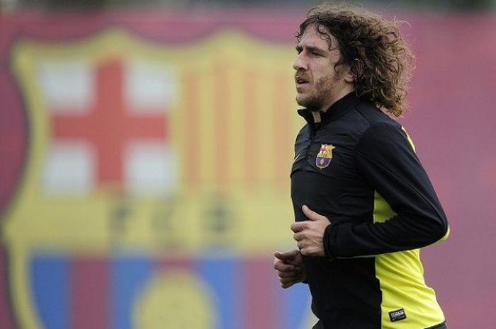 Mantan kapten Barcelona, Carles Puyol, kala masih aktif berkarier sebagai pesepak bola. Puyol gantun