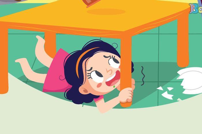 Merunduk di bawah meja saat gempa terjadi.