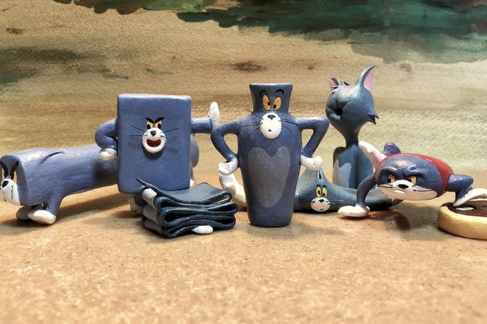 Patung momen lucu Tom & Jerry