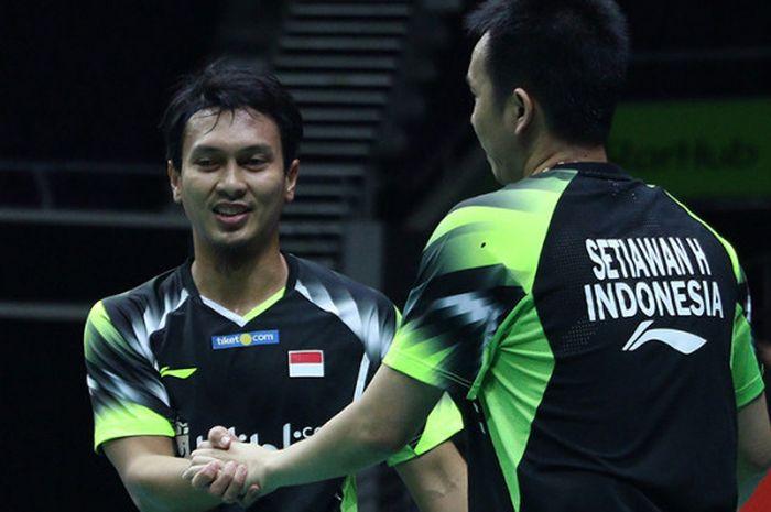 Pasangan ganda putra, Mohammad Ahsan/Hendra Setiawan, merayakan keberhasilan mereka memenangi per