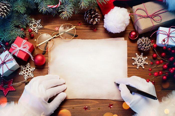 Ilustrasi menulis kartu Natal.
