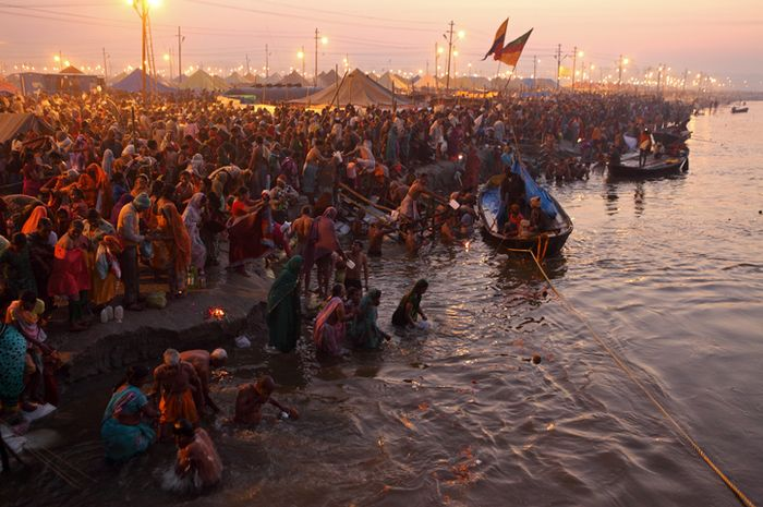 Allahabad, India - February 10, 2013: Allahabad, India - February 10, 2013:Thousands of Hindu devotees come to the confluence of the Ganges and the Yamuna River for holy dip during the festival Kumbh Mela. It is the world's largest religious gathering