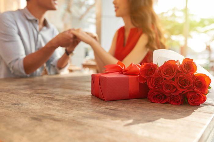 Ilustrasi pasangan yang sedang merayakan hari Valentine.
