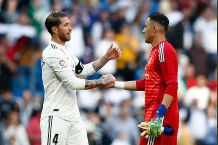 Kapten Real Madrid, Sergio Ramos, berselebrasi dengan Keylor Navas usai laga melawan Celta Vigo, Sabtu (16/3/2019)