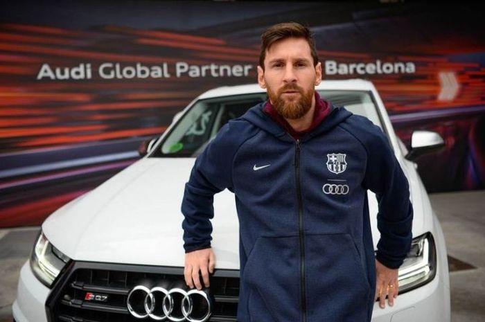 Lionel Messi dan mobil Adui barunya