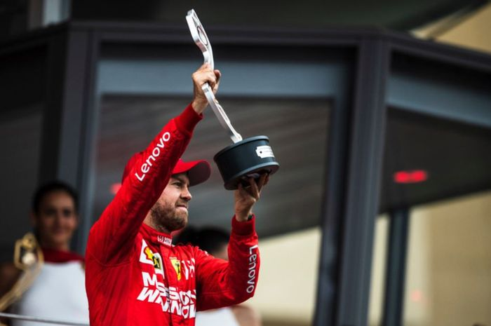 Pembalap Ferrari, Sebastian Vettel lakukan selebrasi usai finis di urutan dua pada F1 Monako 2019, Minggu (26/5/2019)