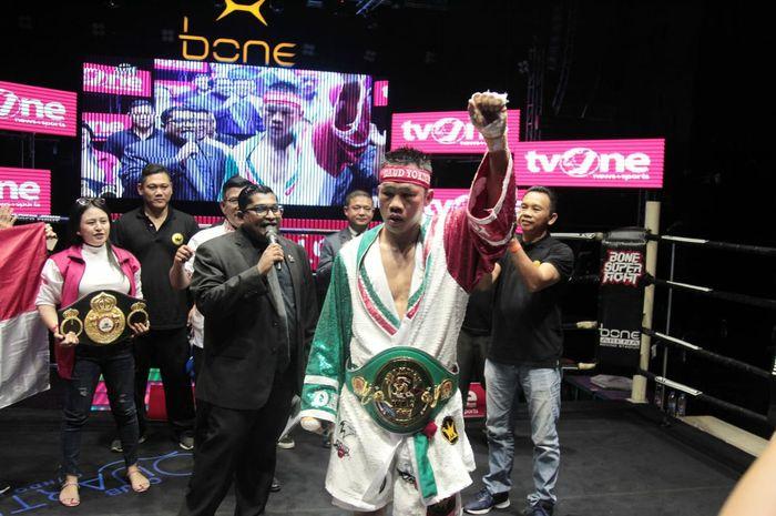 Petinju nomor satu Indonesia, Daud Yordan, usai memenangi pertarungan  WBC International Challenge kelas ringan super di Pattaya, Thailand, Minggu (4/8/2019).
