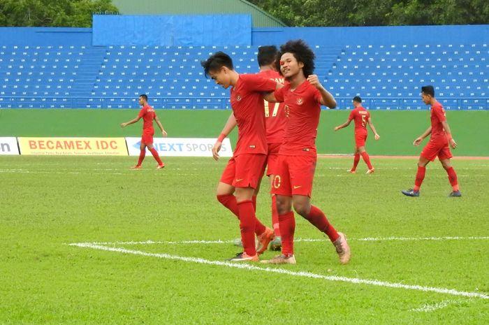 Pemain timnas U-18 Indonesia, Bagus Kahfi merayakan gol yang dicetaknya ke gawang timnas U-18 Brunei di Stadion Go Dau, Vietnam, Sabtu (10/8/2019).
