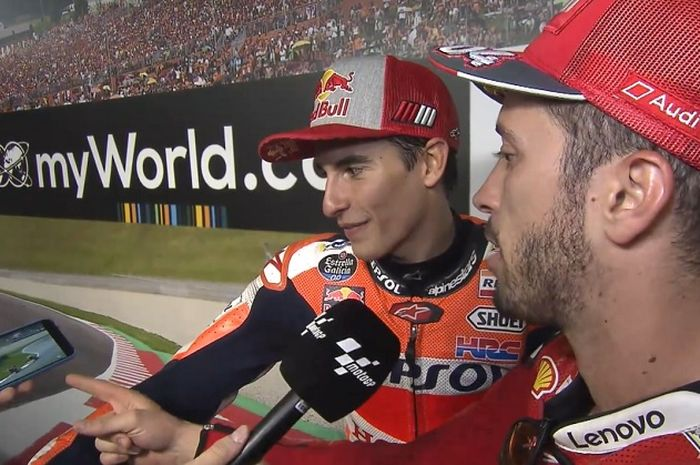 Marc Marquez (kiri) dan Andrea Dovizioso (kanan) saat diminta berkomentar soal duel yang mereka alami pada lap terakhir MotoGP Austria 2019, Minggu (11/8/2019)
