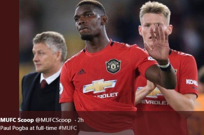 Gelandang Manchester United, Paul Pogba, dalam laga kontra Wolverhampton di Molineux Stadium, Senin (19/8/2019).