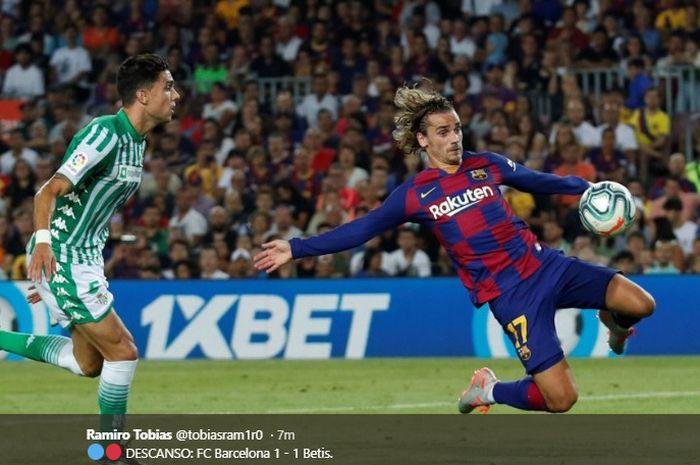 Antoine Griezmann sukses mencetak gol perdananya dan mencetak gol penyeimbang bagi Barcelona kala melawan Real Betis di Stadion Camp Nou, Minggu (25/8/2019).