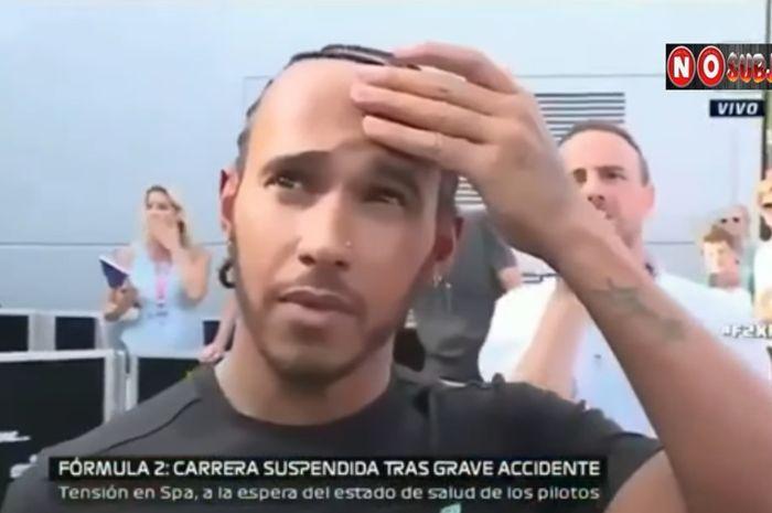 Reaksi Lewis Hamilton saat menyaksikan kecelakaan maut yang terjadi dalam balapan Formula 2 GP Belgia yang terjadi di Sirkuit Spa-Francorchamps, 31 Agustus 2019.