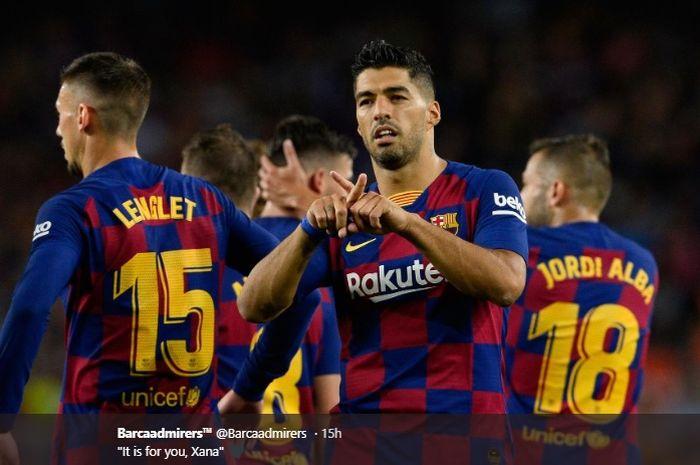 Selebrasi Luis Suarez usai mencetak gol keduanya pada pertandingan Barcelona kontra Valencia dalam lanjutan Liga Spanyol, Sabtu (14/9/2019).