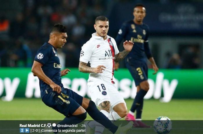 Aksi gelandang bertahan Real Madrid, Casemiro, ketika mencoba menghalau bola yang mengarah kepada Mauro Icardi pada pertandingan penyisiha Grup A Liga Champions, Rabu (18/9/2019) atau Kamis dini hari WIB.