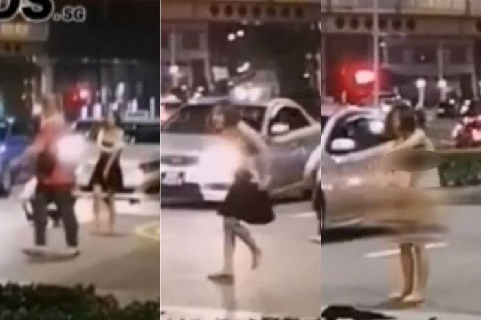 Gadis nekat buka baju di tengah jalan raya