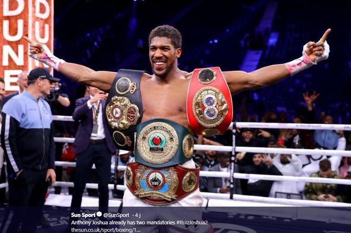 Petinju, Anthony Joshua berhasil merebut kembali gelar IBO, IBF, WBA, WBO dalam pertarungan ulang melawan Andy Ruiz Jr di Diriyah Arena, Arab Saudi, Minggu (8/12/2019)