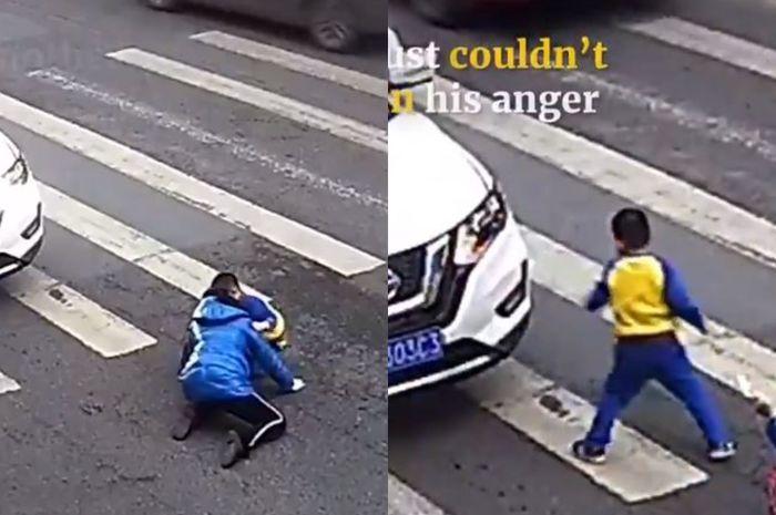 Dengan heroiknya, seorang bocah di China mengamuk dan memaki-maki orang yang menabrak ibunya hingga terpental